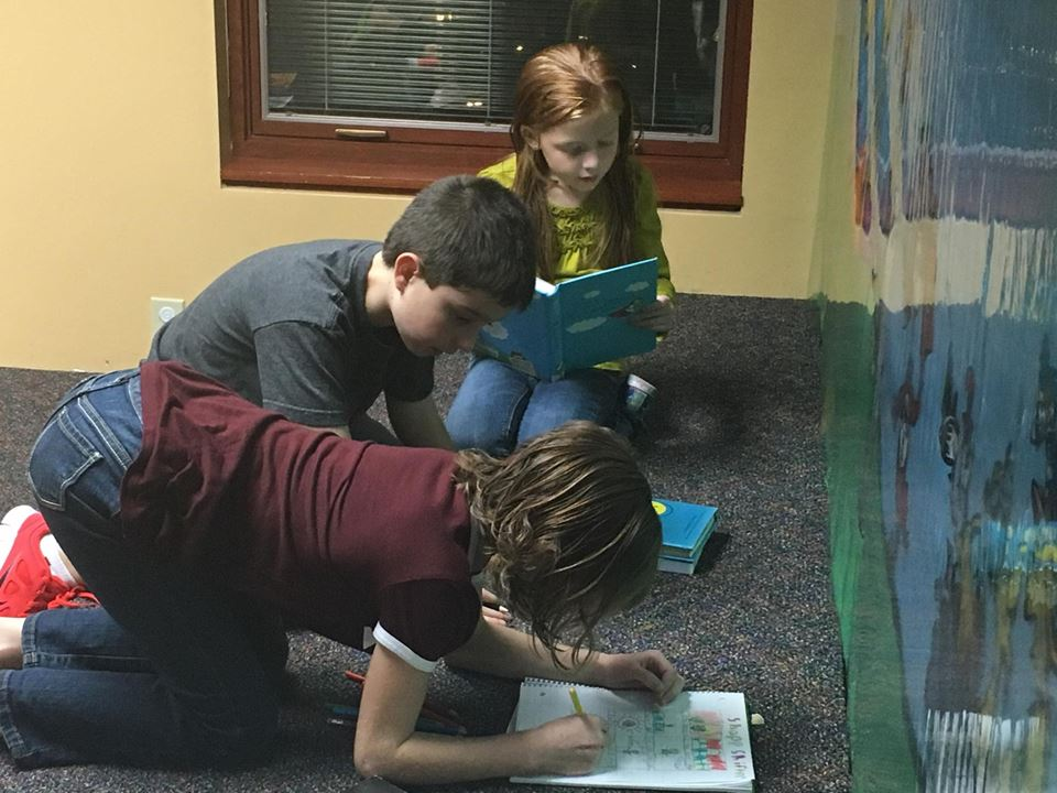Theron and Claire collaborate on a comic together during our Comics Club meeting.