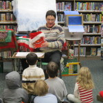 Mr. Dennis (with some help from his sidekick, Danny,) tells the kids a story.