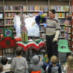 Vern the Bird serenades the children with Christmas songs.