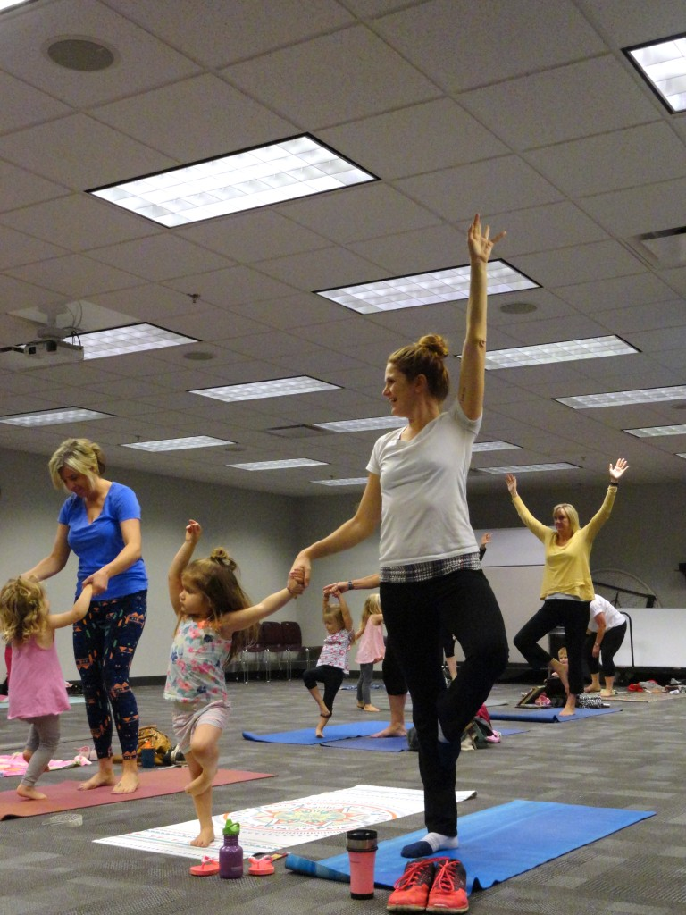 Payton and mom team up for a tree pose during the Books & Yoga program at Mentor Public Library.