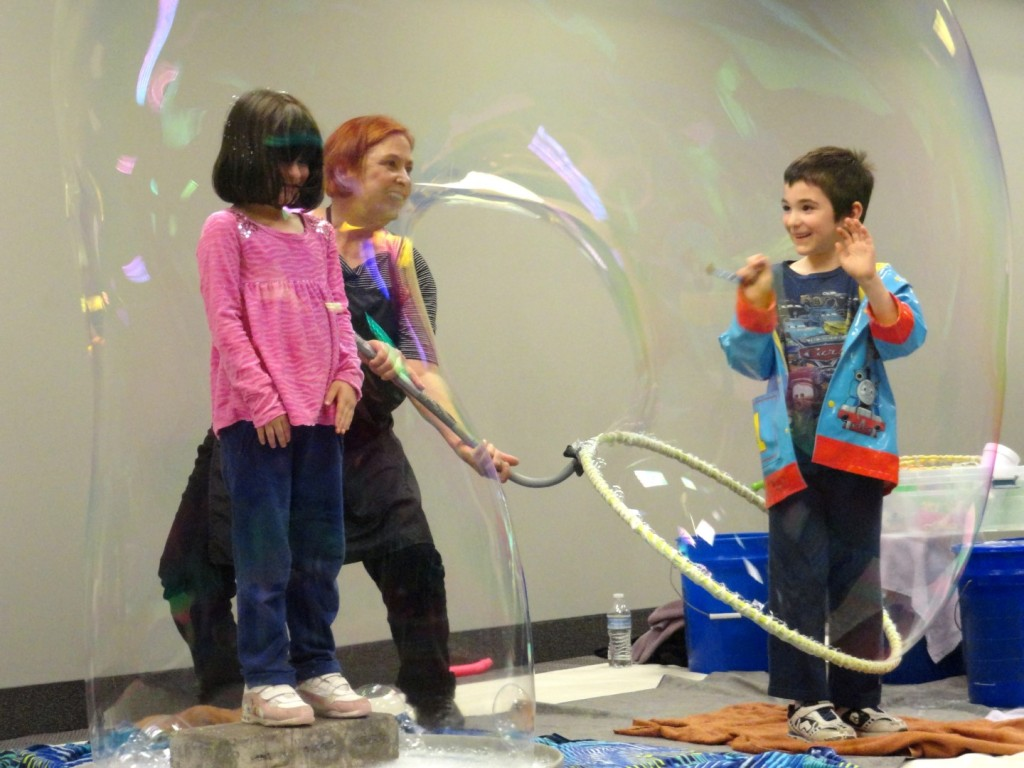 Vincenzo and Bella share a bubble during the Summer Reading Kickoff Party.