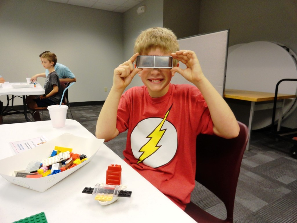 Ian builds a visor during our Family LEGO Challenge.