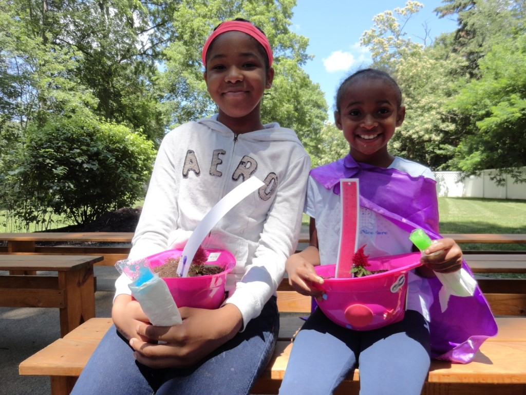 Amerie and Aniyah are all smiles with their new flowers.