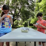 Kids could also make crafts during Make-It Monday. Rowan and Colton shape their optical illusion dinosaurs.
