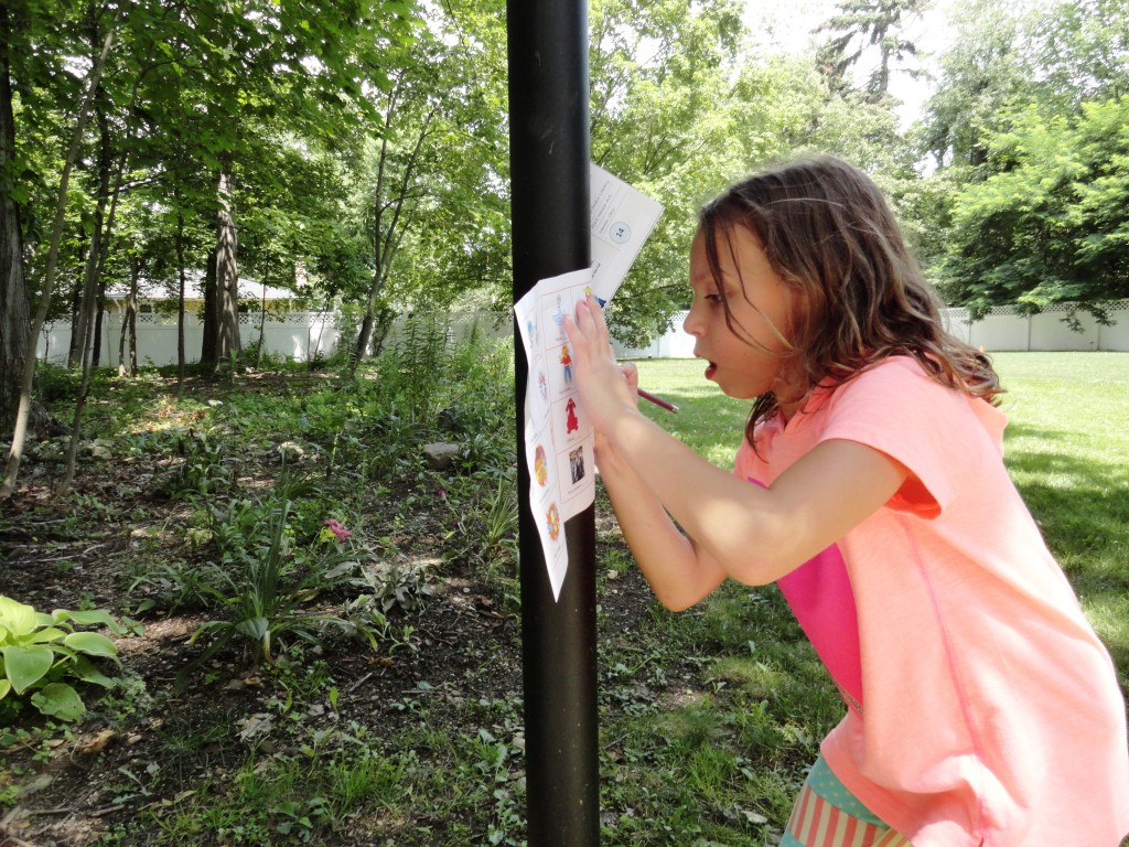 Carly follows a scavenger hunt through our Read House's yard.