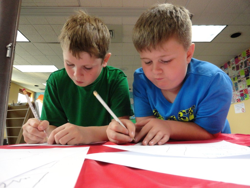 Marcello and Austin collaborate on a comic together during our Comics Club meeting.