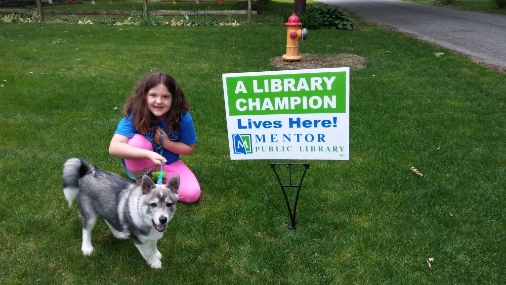 To be clear, the girl and not the dog is the library champion. The dog is a good dog but Elizabeth is a CHAMPION.