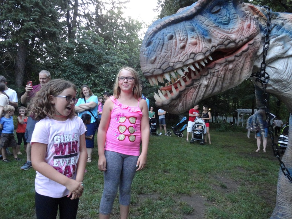 Payton Wagner can't decide if she wants to hug Roxie the Dinosaur.