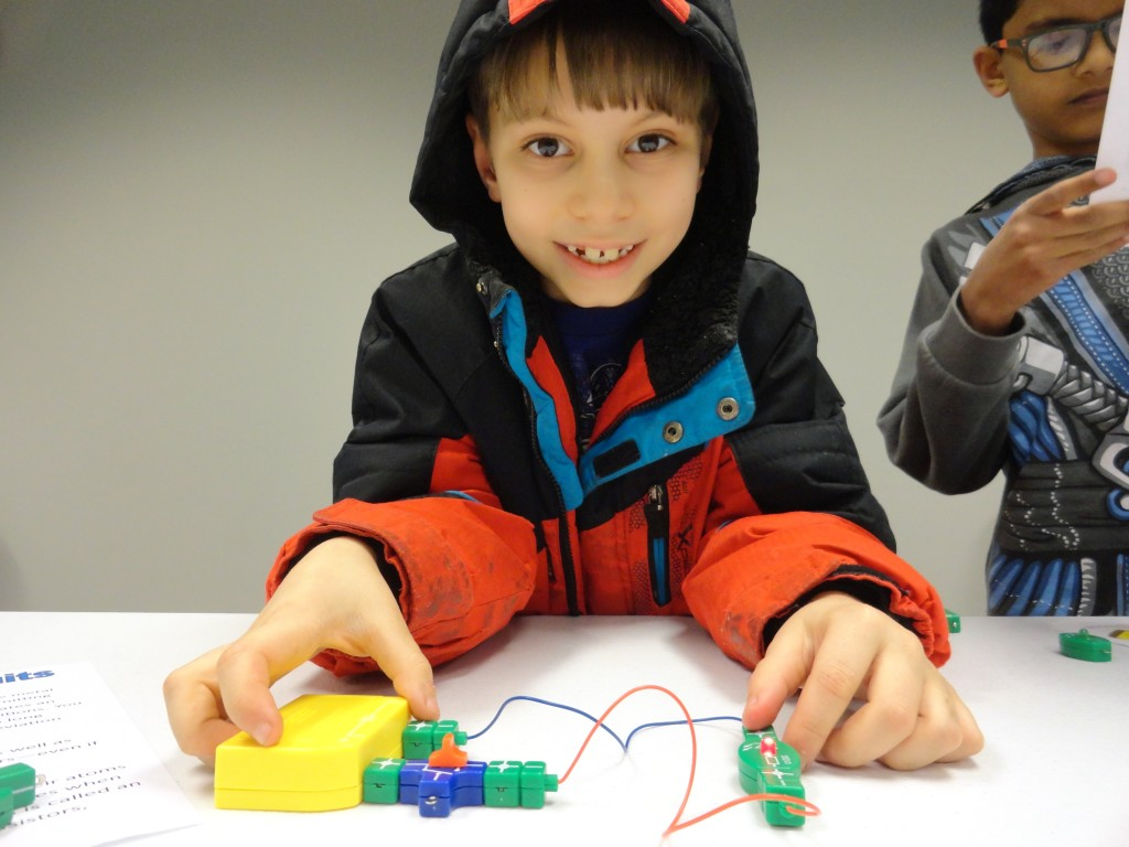 Avery Betteys' bulb lights when he completes his circuit during the STEAM series at Mentor Public Library.