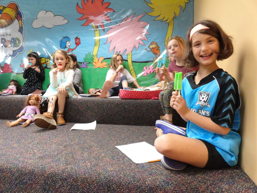 Our American Girl Book Club enjoys a snack during its meeting earlier this month.
