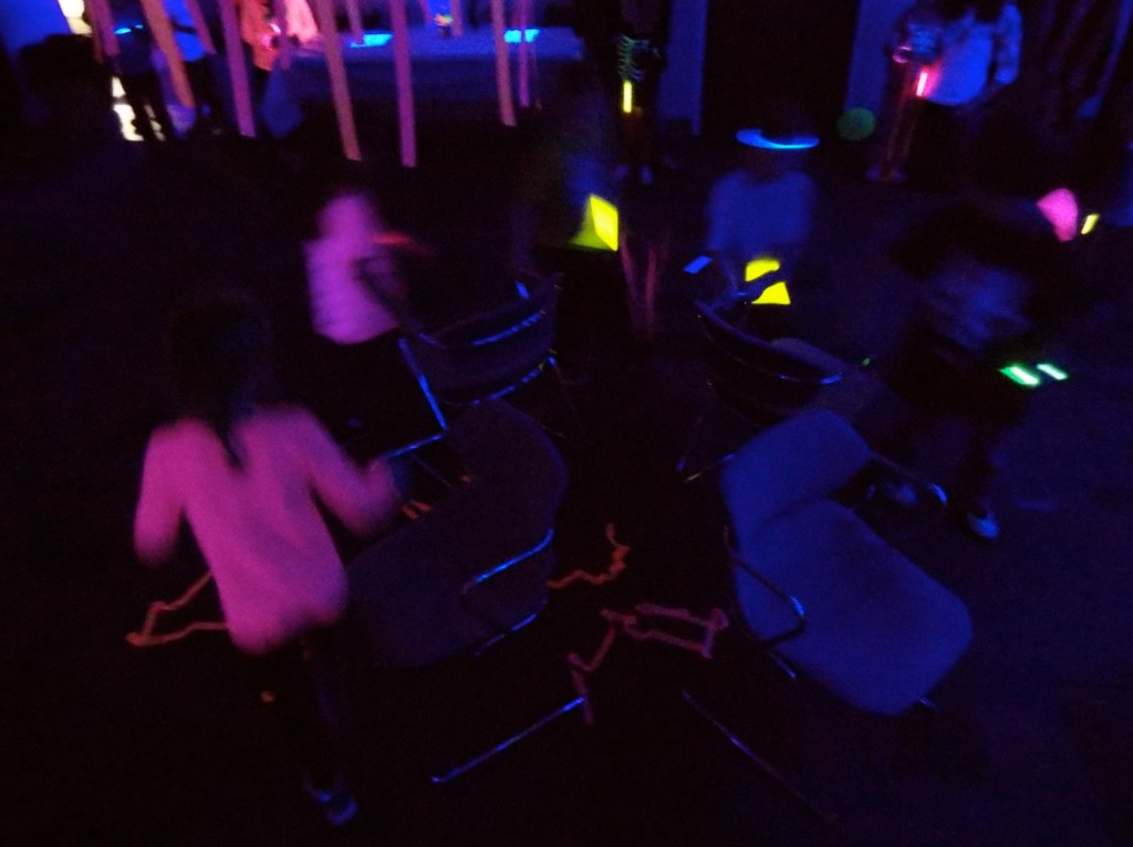 We play a round of musical chairs in the dark.