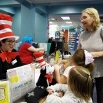 Ms. Amy dresses as the Cat in the Hat for Dr. Seuss's birthday.