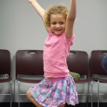 Lily demonstrates her form for tree pose.