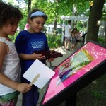 Kids stroll down our new Storybook Walk.