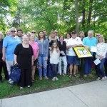 Family and friends of Carol Mononen help us dedicate the new Storybook Walk in her memory. Mononen was the president of the Friends of the Mentor Public Library when she passed away last year.