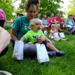 Families relax during the magic show on our Read House lawn.