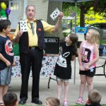 Mr. Zap performs two bits of magic at once: guessing Julian's card and pulling a 3 1/2 of spades.