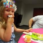 Chomp! Madelyn takes a big bite of cupcake.