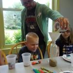 Mr. Josh puts a little more sand in caleb's maraca.