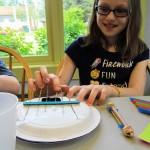 Julia plucks a key on her kalimba.