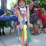 Veronica shows off the hula skirt she made.