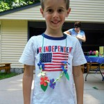 Caleb models his lei (and was already ready for the Fourth of July!)