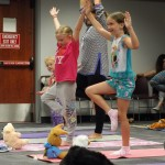 Kids use their stuffed buddies as drishti (or focal points) to aid their balance