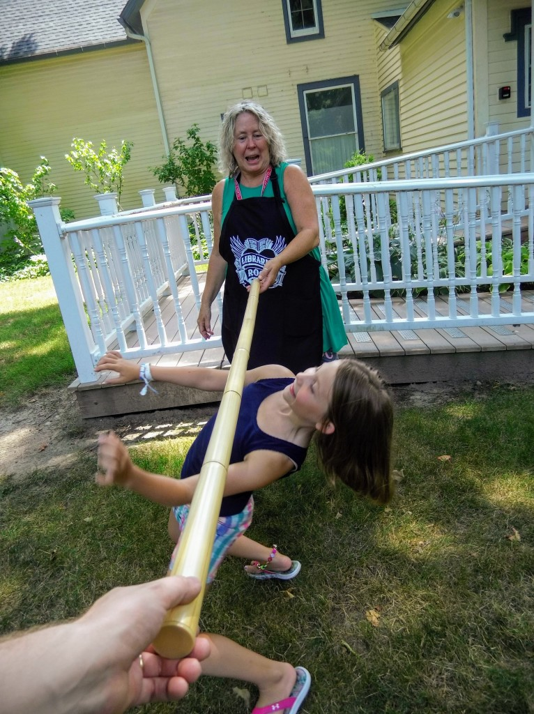 Juliana sees how low she can limbo.