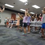 The kids use maracas to learn about percussion instruments.