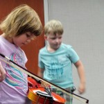 Zin! Zin! Zin! Veronica plays the violin.