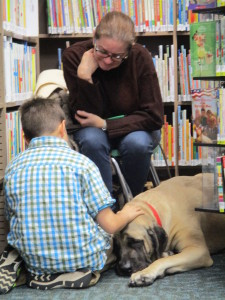 Avery reads to Miss Marlee during Paws to Read.