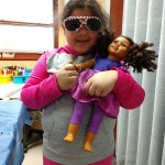 Makayla models her newly bedazzled sunglasses.