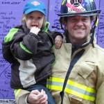 Firefighter Jerry shows Maxx the fire truck.