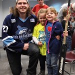 Ivan Vilcauskas takes a team photo with Ryann and Shelby.