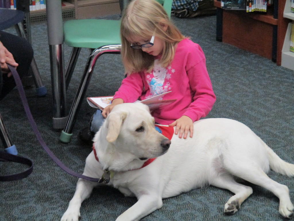 Jolee and Makayla share a story during Paws to Read at the Headlands Branch.