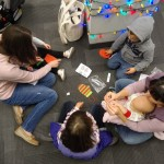 After story time, kids crafted stockings that they could hang on their trees.