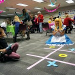 Alice in Wonderland joins Gianna for a game of Tic-Tac-Toe.