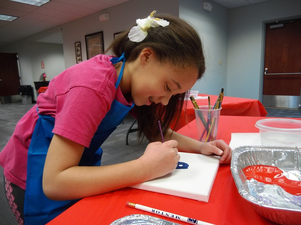 Emma seeks inspiration from Frida Kahlo during our art program on Tuesday.