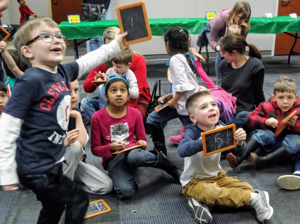 Kids try to guess the value of store-brand peanut butter during a Money Smart program at Mentor Public Library. (Correct answer: $1.39.)