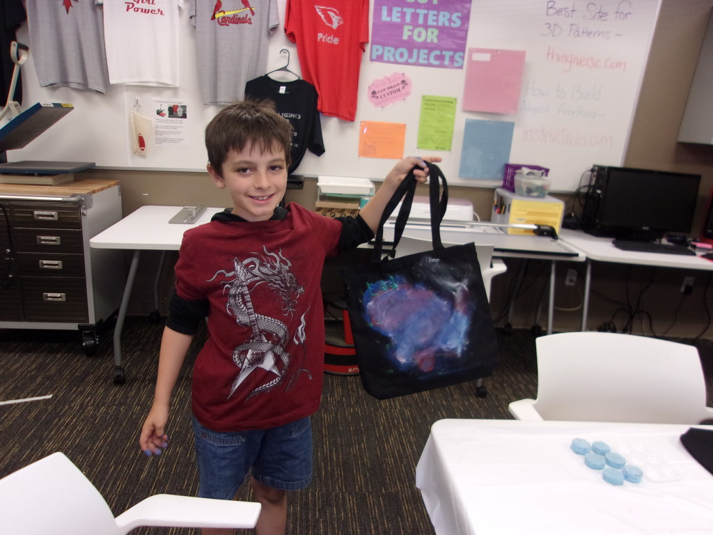 Eli shows off the stellar tote bag he customized at The HUB.