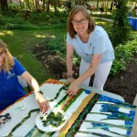 MPL Reference Director Amy and Executive Director Cheryl help make the Mentor Marsh mosaic.