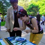Our Board President Diane and the Friends of MPL President Carrie help complete the community mosaic.