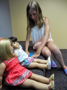 Dolls are welcome at our American Girl Book Club, but you don't need one to join.