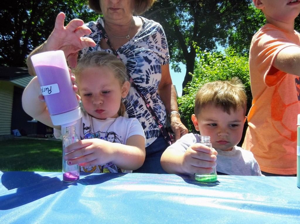 Kids fill their bottles with colorful sand on another Marvelous Monday on our Main Branch lawn.