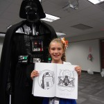 Darth Vader was kind enough to sign this young Jedi's book.