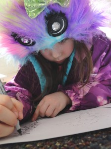Don't be distracted by the fuzzy purple hood or the green sequin bow. Gavyn's doing some precise inkwork.