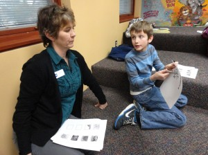 Caleb confers with Ms. Judy during Studio MPL.