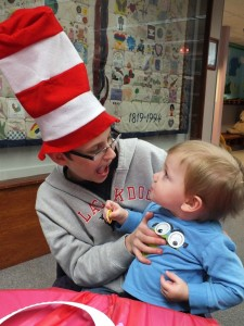 Sixteen-month-old Bo Brauer stares at the Dr. Seuss hat worn by his brother Kirk Brauer during the Mentor Public Library's Dr. Seuss Weekend Celebration party last year.