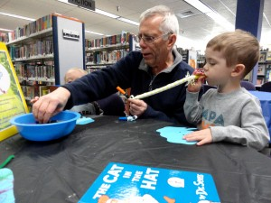 Paul helps his grandson, Jordan, make a Horton mask (complete with a noisemaker for a trunk.)