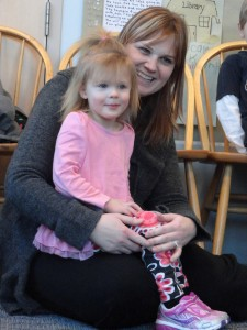 Olivia and her mom, Sara, listen to Green Eggs & Ham during a story time at our Lake Branch.